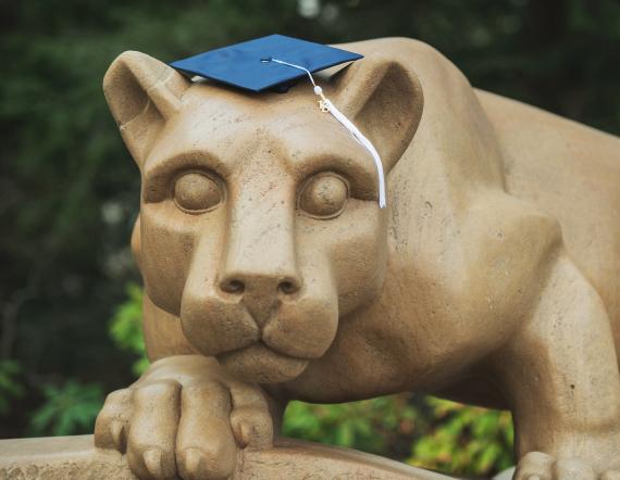 Nittany Lion shrine with a graduation cap